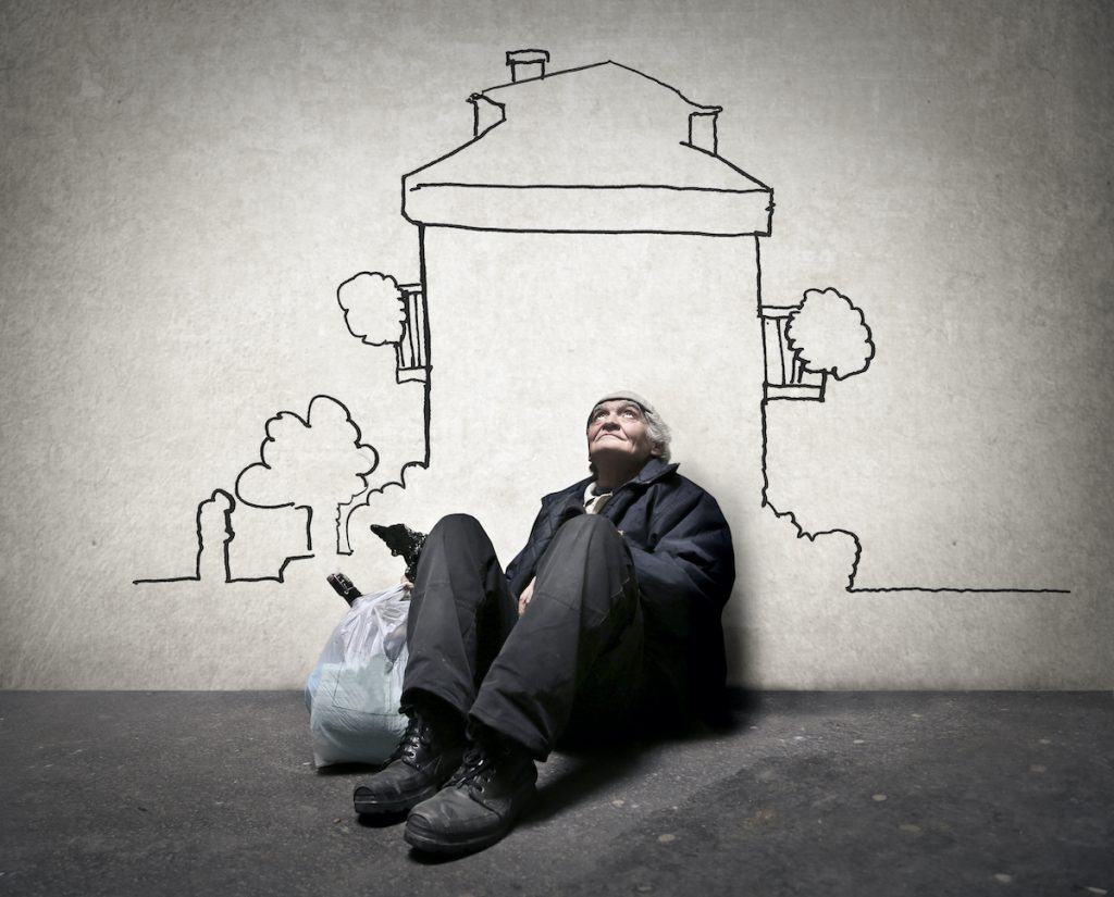homeless man in front of a drawing of a house