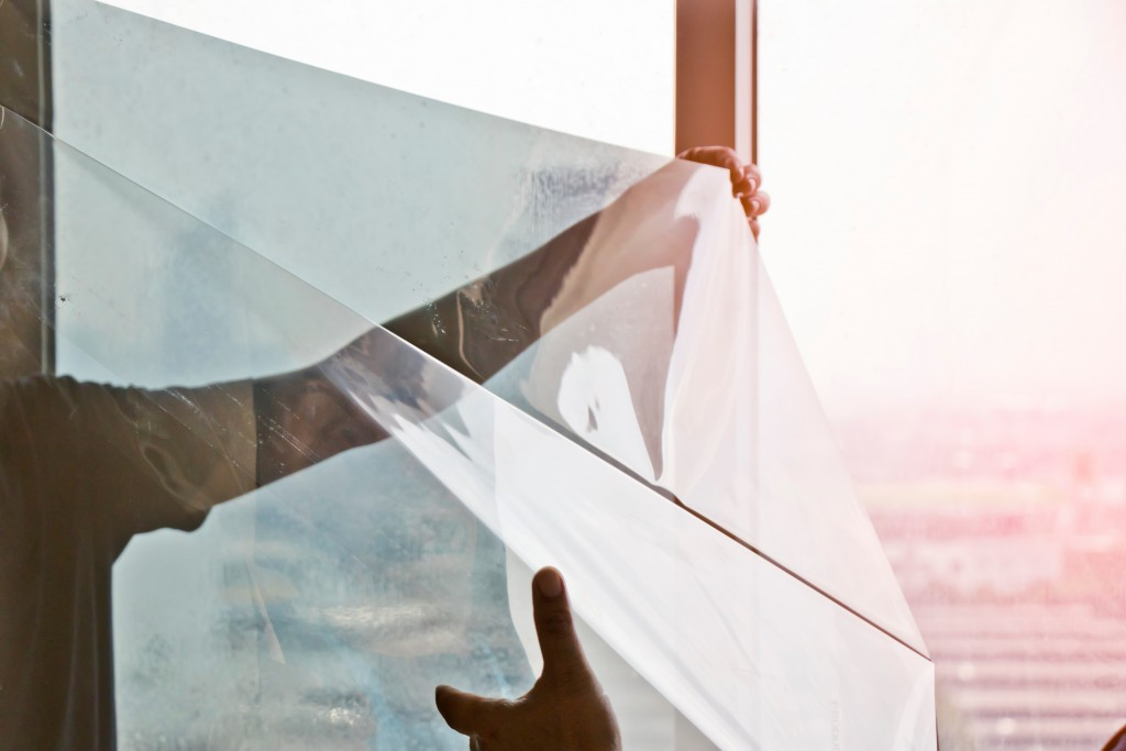 person installing window film