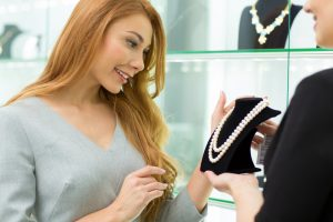 woman enticed in buying a jewelry